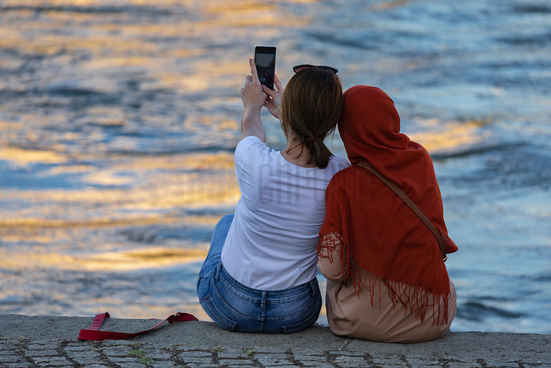 "Two Women Take a ""Selfie"" on the Bank of the Vardar River"