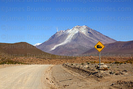 Steep downhill road sign and Ollagüe volcano, Nor Lípez Province, Bolivia