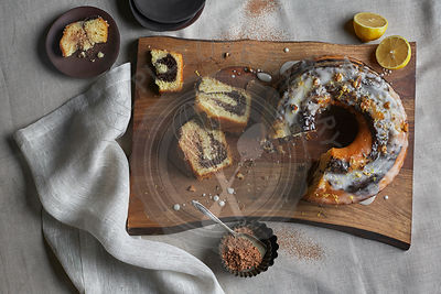 Chocolate and Lemon Swirl Bundt Cake on a Bark Lined Wood Cutting Board