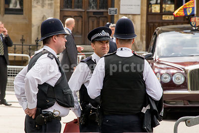 Three Met Police Officers chatting outside Westminster Abbey