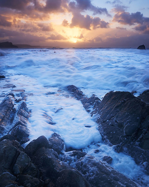 Sunrise in fierce winter storm at Mupe, Dorset on the Jurassic Heritage Coast. There were severe gale force winds and huge wa...