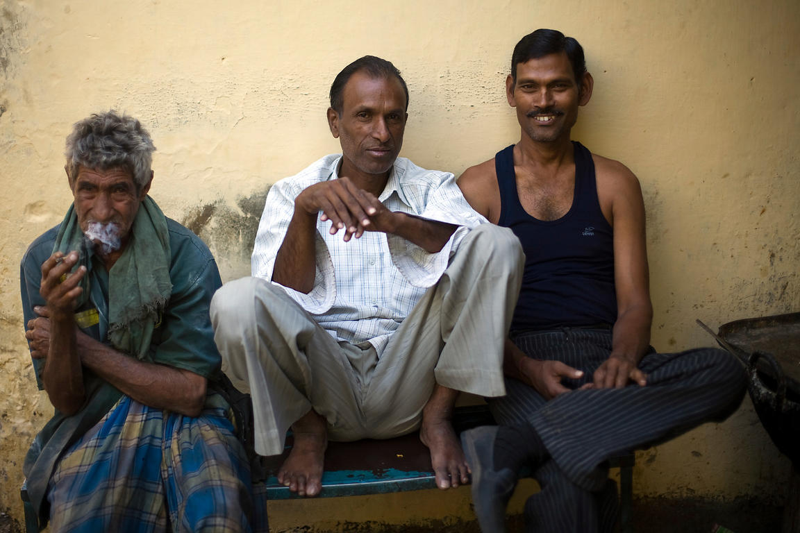 India - Jaipur - Men sit ouside a tea stall