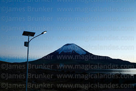 Solar powered street light and Parinacota volcano before dawn, Lauca National Park , Region XV , Chile