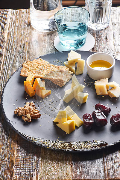 Vertical shot of cheese platter served with crackers