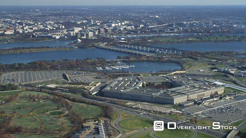 Wide view of the Pentagon with Washington DC across Potomac in background  Arlington National Cemetery at left.