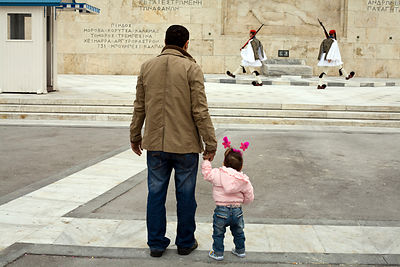 Greece - Athens - A father and his daughter watch two Greek soldiers perform the Changing of the Guard in front of the Tomb o...