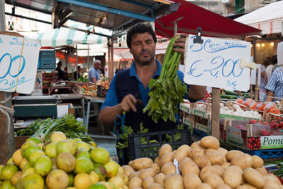 Italy - Palermo - A market trader cleans celery on his stall in the Capo Market