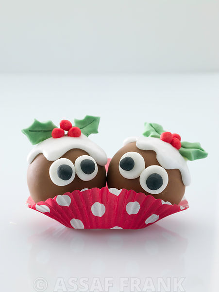 Christmas pudding cupcake on white background