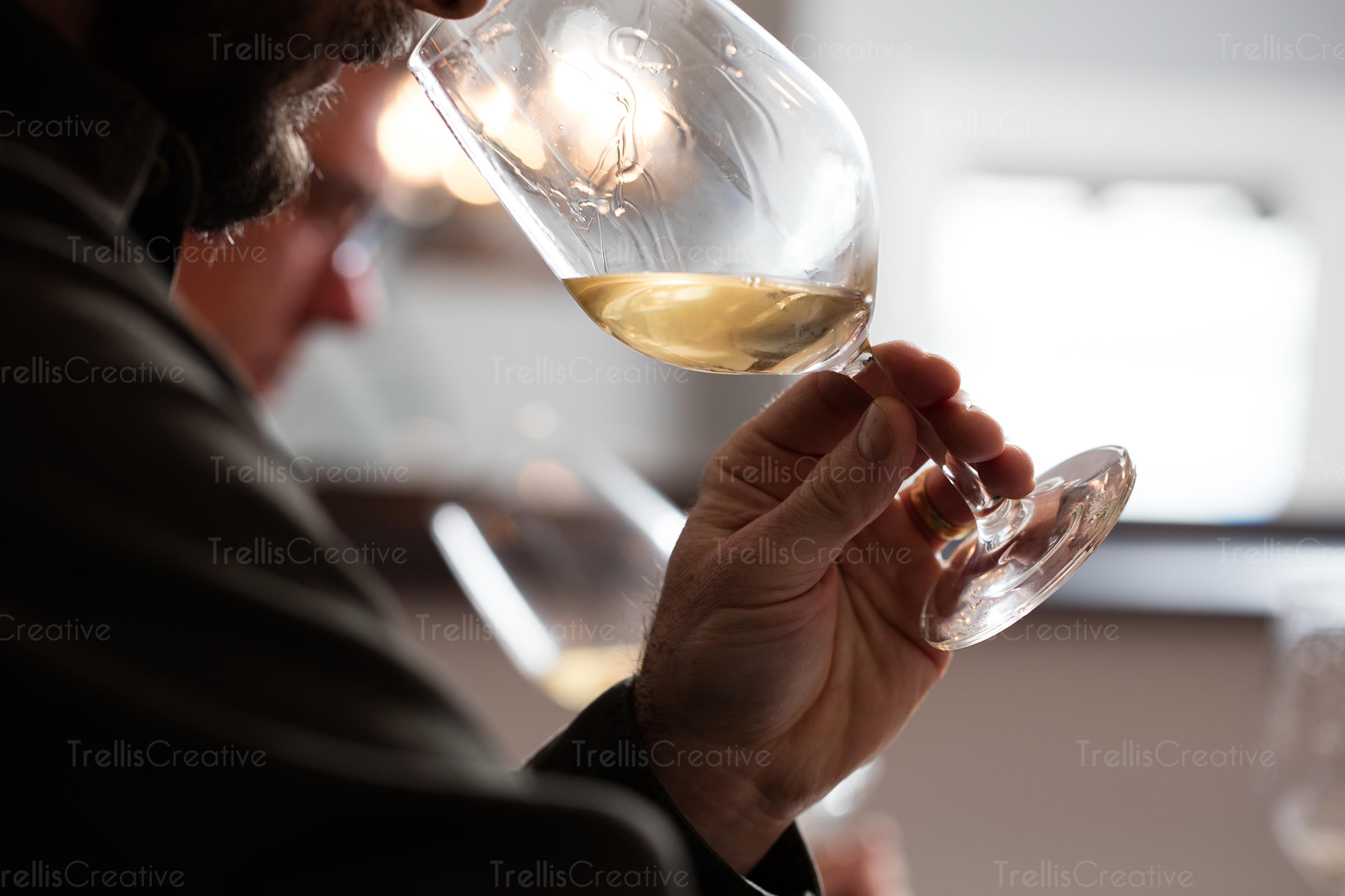 Close-up of a man drinking white wine