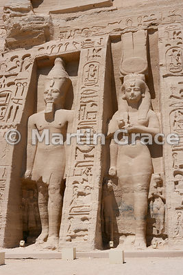 Colossi of Ramesses II (left) and Queen Nefertari (right) on the facade of the Temple of Hathor, Abu Simbel, Egypt