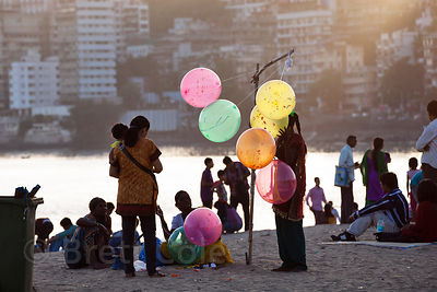 A woman sells balloons on Chowpatty Beach, Mumbai, India.