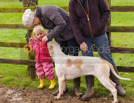 Young hunt supporter with a hound - The Cottesmore Hunt at Tilton on the Hill, 9-11-13