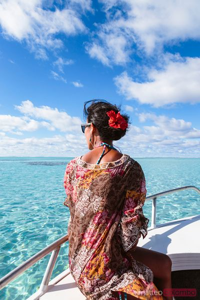 Woman on boat in the lagoon of Aitutaki, Cook Islands