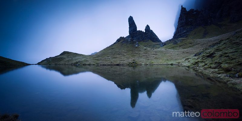 Old man of Storr reflected in small lake Scotland UK