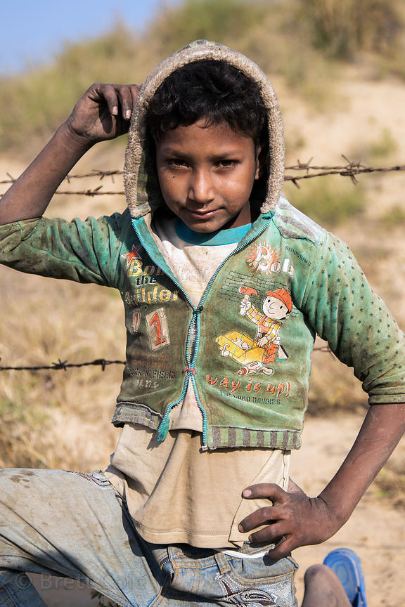Boy from a low income family in a remote part of the Pushkar desert, Kishanpura Goyla village, Rajasthan, India