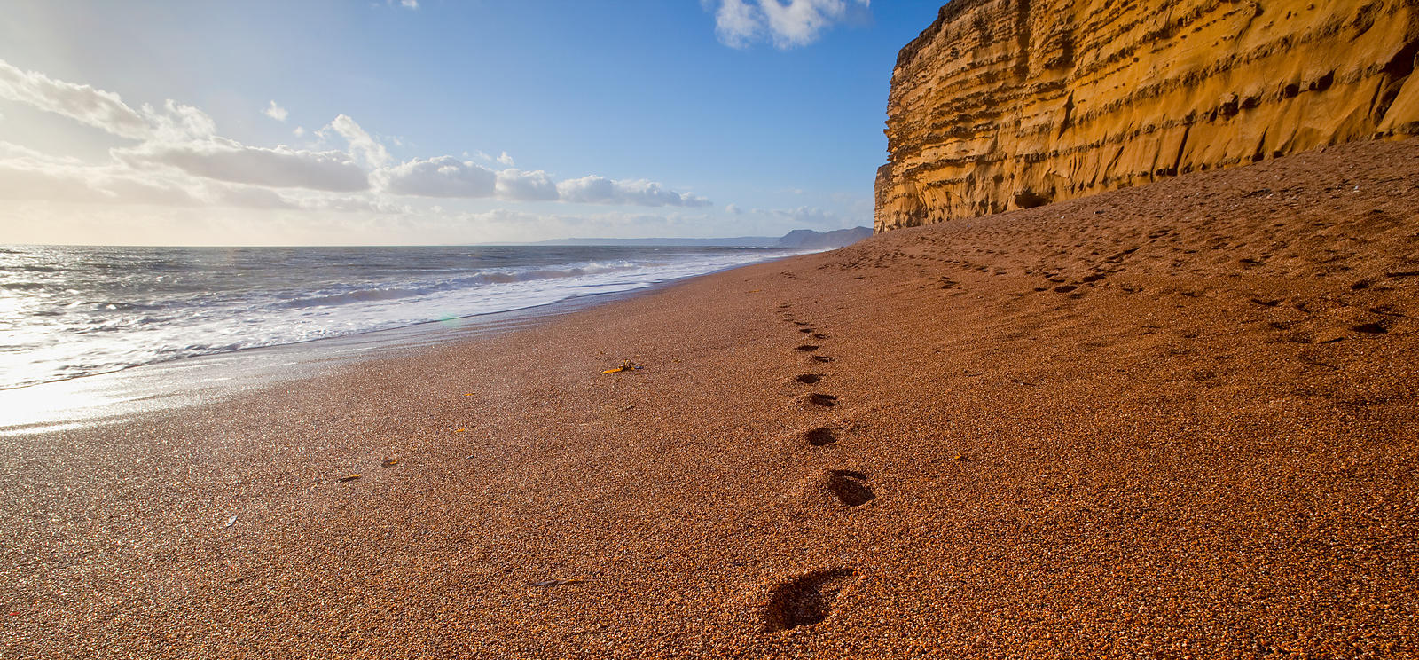 Footprints in the sand at Burton Bradstock