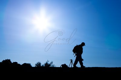Silhouette of Photographer With Backpack in Morning