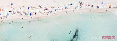 Aerial panorama of beach crowded with people, Spain