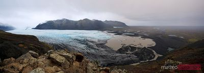 Glacier ending in a lake in stormy weather Iceland