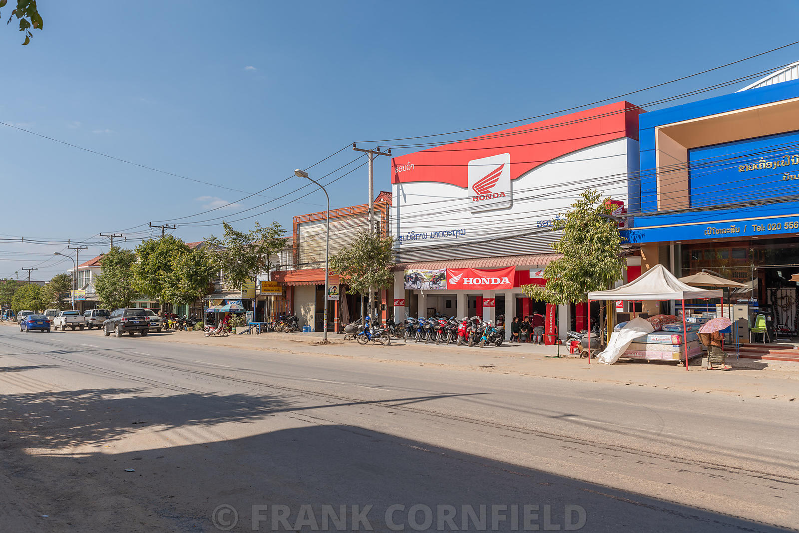 PHONSOVAN, LAOS - JANUARY 28, 2019:  The main street in the commercial and retail area of Phonsovan in Laos.