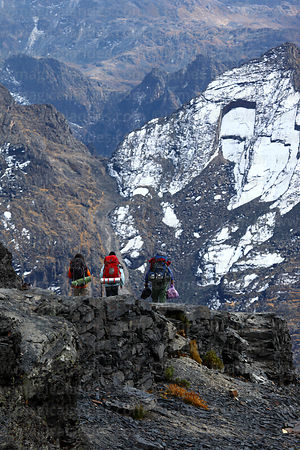 Trekkers on El Choro Inca Trail just below Apacheta Chucura, Cotapata National Park, Bolivia