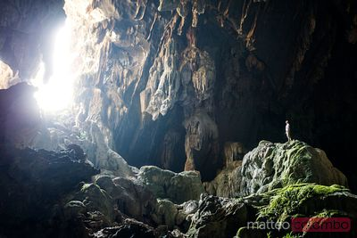 Man inside a cave in Vang Vieng, Laos