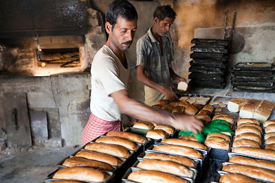 India - Chandannagar - Bakers at work in a bakery