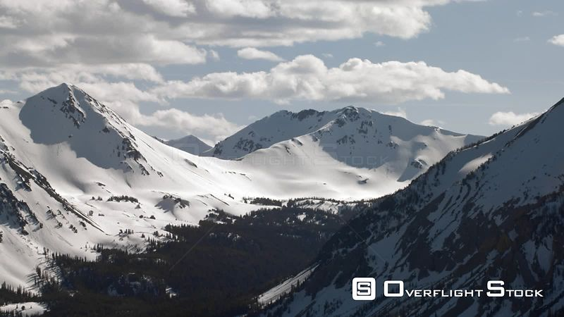 The snowcapped peaks of the Madison mountain Range between Yellowstone National Park and Bozeman, Montana