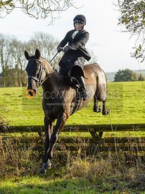 Sophie Walker jumping a hunt jump