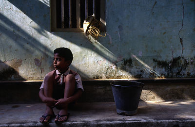 India - Kerala - A boy collects milk