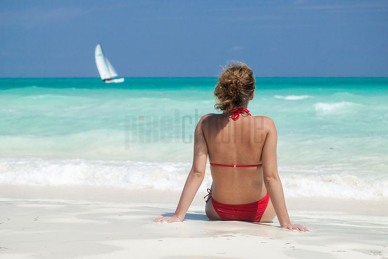 Woman in Red Bikini on Cayo Guillermo Beach