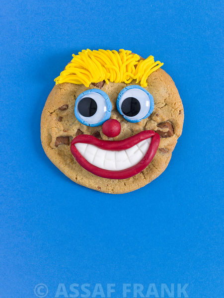 Face shaped biscuit on blue background