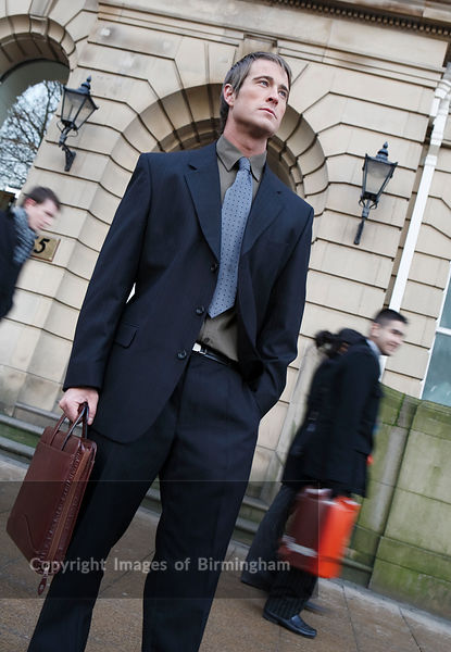 Business man carrying briefcase in the financial district of Birmingham, on Colmore Row.