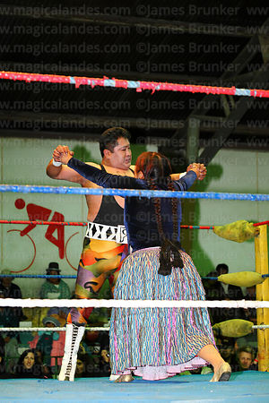 Cholita and male wrestler performing in El Alto, Bolivia