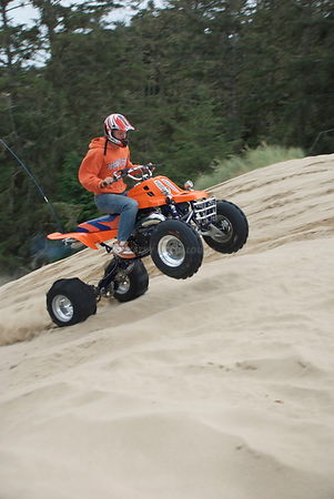 Boy four wheeling at Oregon Coast dunes