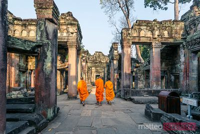 Buddhist monks walking in a temple, Angkor Wat, Cambodia