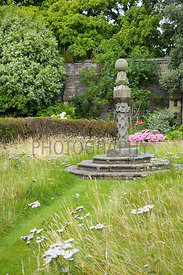 Sundial and Achillea in wild flower meadow