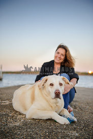 yellow lab on waterfront docks with owner
