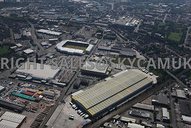 Warrington high level aerial photograph over looking  Asda distribution centre Dallam Lane towards Tesco supermarket and the ...