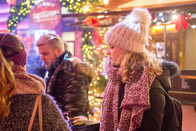 Young Woman wearing a white bobble hat at the Santa Pauli Christmas Market in Hamburg