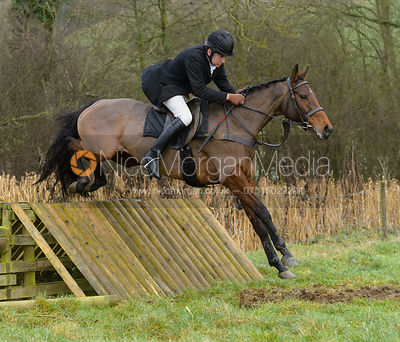 Russell Nearn jumping a hunt jump at Peakes - The Fitzwilliam Hunt visit the Cottesmore at Burrough House