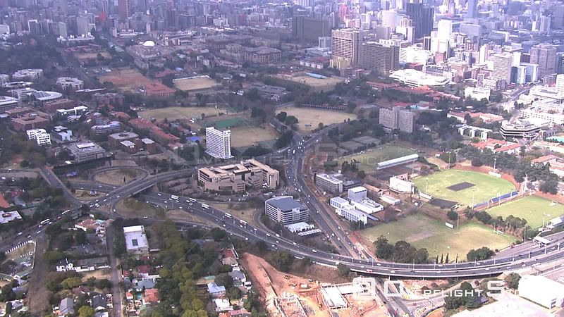 Aerial shot of the Springbok rugby team's bus travelling on the highway Johannesburg Gauteng South Africa