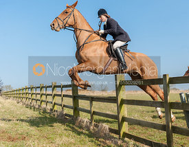 Victoria Westropp jumping a hunt jump near the meet at Goadby Marwood