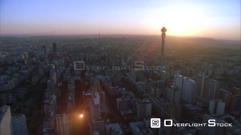 Aerial shot over Johannesburg Central Business District with the Hillbrow Tower towering above and passing the Ponte Tower du...