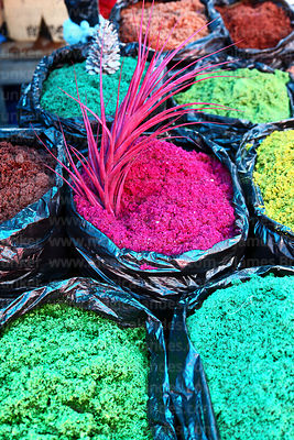Coloured sawdust for making nativity scenes for sale in Christmas market, Bolivia