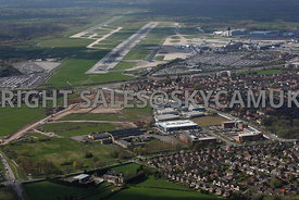 Manchester aerial photograph of Manchester Airport showing Terminal buildings and runways and Ringway Trading Estate and the ...