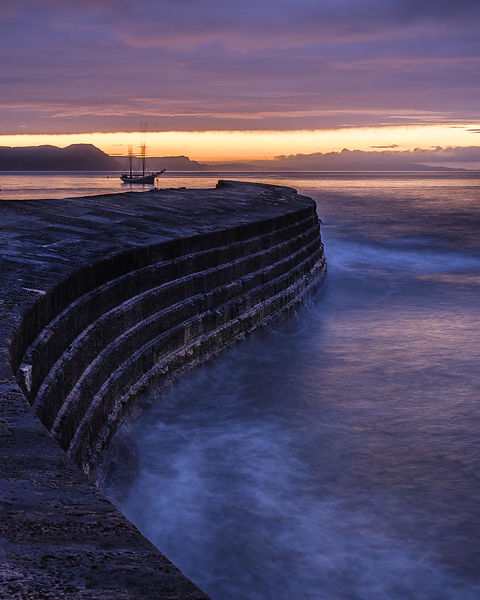 Twilight with Irene anchored off The Cobb in Lyme Regis, Dorset, UK