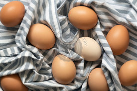 Fresh brown and white hen eggs.