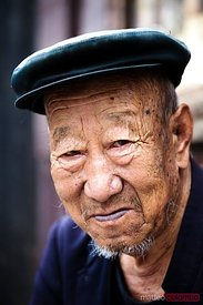 Portrait of old chinese man in Pingyao, China