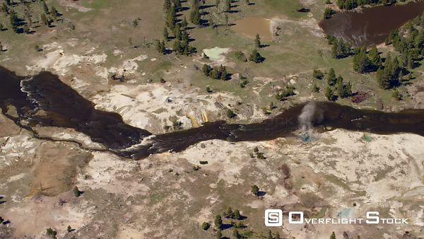The Firehole river flows through the Midway Geyser Bain in Yellowstone National Park